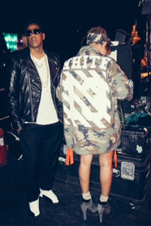 Jay-Z in Pearls w Beyonce in a nice Number 13 Jacket/shirt