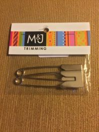 M&J Trimming has many silver and gold safety pins in many different sizes